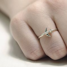 This is handmade ring with airplane from the collection A plane to luck. This cute ring is an excellent gift for stewardess, and who love sky. The airplane is symbol of the travel, will always be with you on your trip. Suitable for wearing 24/7 as well as for special occasions. You