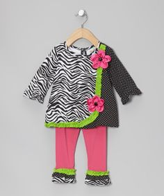 This tunic blends a playful selection of fabrics for a fun, fresh look. It pairs perfectly with the matching leggings for a pretty yet practical statement. Includes tunic and leggings57% cotton / 38% polyester / 5% spandexHand wash; hang dryImported