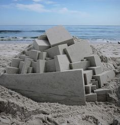Illusion: These unique sand sculptures were built by Calvin Seibert during his free time. The artist has spent a day here and there constructing the castles, but he wishes, he could spend 6 weeks on the beach doing a lot more!  http://illusion.scene360.com/art/35896/ultra-modern-sand-castles/