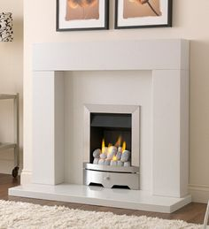 The Valor Seattle slimline gas fire is sleek sophisticated and has a brushed steel curved front and beautiful pebble fuel bed, making it the ideal choice for any contemporary interior. Cream Fireplace, Inset Fireplace, Fireplace Wall, Fireplace Design, Contemporary Gas Fires, Contemporary Interior, Valor Gas Fires, Valor Fireplaces, Family Room Fireplace