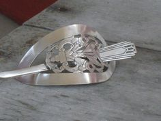Upcycled Silverware   Stick Barrette   $25  Put the silverware thru some kind of rolling press???? you people are SO AMAZING!
