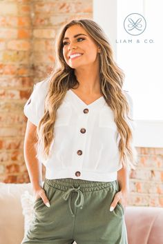 We are loving the minimalist vibes of our Aaliya Button Front Top, and you will too! Our top features a v-neckline, rolled sleeves, front pockets, and a button up detail on the front. The woven fabric is soft and lightweight making it the perfect addition to every closet this season! Wear it with your favorite mom jeans or dress it up a bit with a fun skirt, either way you're sure to love the way you look and feel!