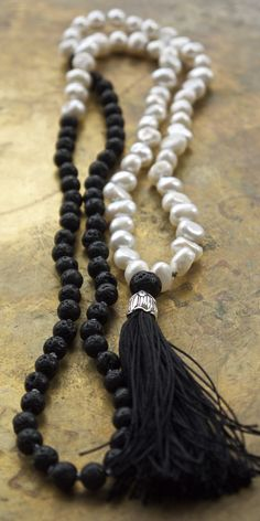 Modern, minimal mala beads with black lava rock and freshwater pearls from Pillow Book Designs // Gorgeous boho chic design.