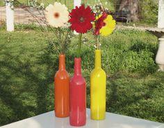 Spray painted wine bottle vases. love.