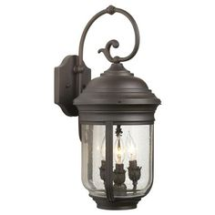 A welcome addition to any home, this traditional outdoor fixture is absolutely stunning. 22 high x 9 wide. Extends 11 from wall. Backplate is high x 5 wide. Uses three 60 watt candelabra bulbs (not included). Style # 04392 at Lamps Plus. Wall Lights, Lamps Plus, High Walls, Candelabra Bulbs, Wall Lantern, Wall, Outdoor Walls, Wall Lamp, Indoor Outdoor Lighting