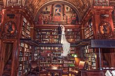 A historic library sets the scene for a grand wedding photo of the bride and groom. | A Day of Bliss Photography in New York, NY