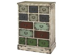 Shop for Powell Furniture Parcel 13 Drawer Cabinet, 990-333, and other Bedroom Chests and Dressers at Exotic Home in Virginia Beach area, Norfolk area, and the Outer Banks. The Parcel Cabinet will add vintage character and interest to any area of your home. The cabinet has a distressed white frame and multicolored distressed drawer fronts that give the piece a vintage, industrial flair.