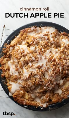 This Cinnamon Roll Dutch Apple Pie is like a cinnamon roll flavor explosion with apple pie filling in between. A cinnamon roll crust on the bottom, a sugary streusel and cinnamon swirl icing on top and delicious baked apple filling in the middle- this pie is a serious must-make dessert.