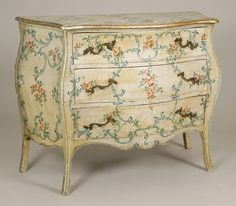 Italian Rococo Style Painted and Silver-Gilt Commode 19th Century The serpentine top above a conforming case enclosing three long drawers, raised on splayed legs, the whole decorated with C-scrolls and flowerheads.