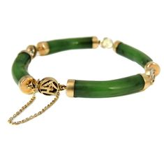 A vintage Jade and 14k bracelet that will not disappoint! Each Jade link is curved to sculpt the wrist and capped in buttery 14k yellow gold. In between each