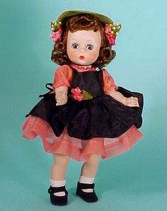 Garden Party Alexander-kins, 1955, black taffeta pinafore with flowers matching those on green straw hat. Rose/pink organdy dress.