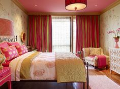 This is such a gorgeous, super-girly room. I love the painted ceiling; easy transition from nursery to child's room