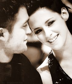 Robert Pattinson with Kristen Stewart.....