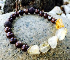 Citrine Nugget, Garnet and Lava Essential Oil Bracelet  Comes with 1 ml vial of oil. When placed on the lava stone, it will absorb and diffuse for up to 3 days. Then reapply. [ LavHa.com ]