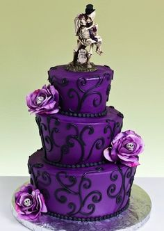 I like this cake minus the skeletons and flowers... Ideas ideas maybe I can get someone to make this or maybe I will.