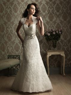 Fabric:Lace  Embellishment : Floral/Crystal   Silhouette: Column/Sheath  Neckline:Queen Anne  Strap: Strapless  Sleeves:Sleeveless  Hemline: Floor-length  Back: Zipper up  Train : Chapel Train  PHOTOGRAPHED IN:Ivory    Estimated Delivery Time: 30-40 days  $420.00
