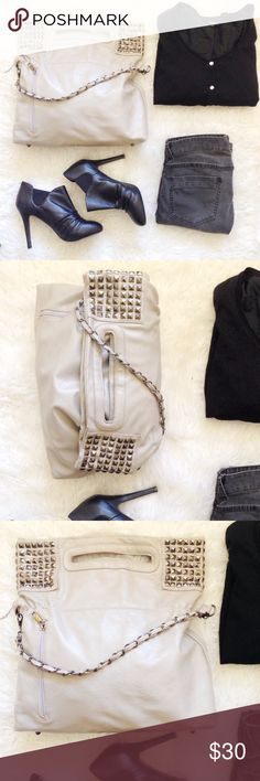 Studded Gray Foldover Bucket Bag Chain Strap Love this bag!!! I will miss it. It's so pretty. Taupe/warm gray, smoky colored studs and chain. Zipper pouch on outside. Zippered pocket plus two open smaller pockets inside. Dark brown cotton like lining. Zippered closure to main opening and large handle built into bag. Carry by handle with chain hanging or fold over the top and wear as a shoulder bag. Metal peg feet at bottom. 💋Please note this has been loved. You can see the wear in last…