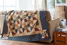 Rustic Stars by Lynne Hagmeier of Kansas Troubles Quilters - American Patchwork & Quilting Oct 2014