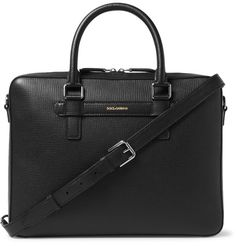 <a href='http://www.mrporter.com/mens/Designers/Dolce_and_Gabbana'>Dolce & Gabbana</a>'s Italian-made briefcase has a neat slim profile, making it ideal for rush hour when bulkier styles can cause commuter irritation. This piece is structured from black leather with a cross-grain finish that's tactile and more resilient towards scratches and scrapes. The two-way zip fastening opens to reveal a muted leopard-print interior punc...