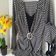 Ladies Tunic Blouse Beautiful black and white houndstooth design on blouse with inner v neck tank with spandex,gathers  at the waist with round buckle, some scratches on buckle. Scalloped edge design black trim on sleeves and bottom of blouse, very dressy look! Very silky and stretchy material. Apostrophe Tops Blouses