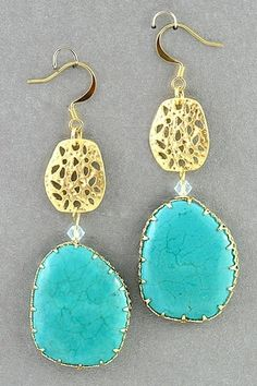 Turquoise and gold earrings.