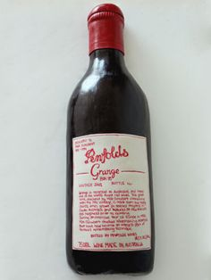 Wine Bottle Cake    Made for a guy's 70th birthday.  www.weelovebaking.com