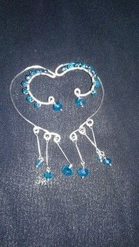 Adjustable earcuffs. Teal faceted beads,  easy to wear and adjust to your ear shape. Brand new hand