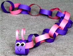 Paper chain caterpillar made with strips of construction paper 1 inch by 10 inches long, glued or taped together and decorated with face when completed.  Who can make the longest caterpillar?
