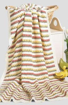 Bands of pretty colors combined with a simple cluster stitch allow you to plant a garden in crochet. You can also choose your own favorite flower colors for this easy to make one-piece throw!