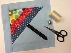 This bright umbrella quilt block pattern will be sure to chase away the blues during those frequent April showers!
