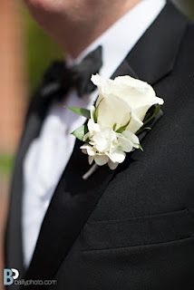 Simple white rose boutonniere with a sprig of white hydrangea at the base.  Anna and Andy, photo by Bailly Photography.
