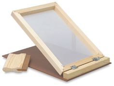 Hinged screen for making prints by silk screen process.