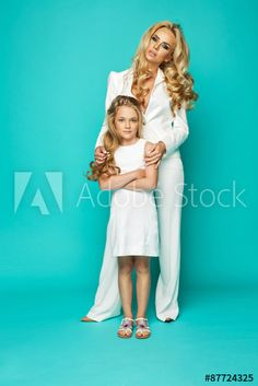 Fashion woman and preatty little girl isolated on white