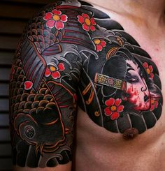 I love thisJapanese half-sleeve tattoo. It's super bold and strong with lots of heavy black ink. The overall design is great and the way the tattoo is position is awesome. #CuratedTattoos #JapaneseTattoo #tebori #koitattoo