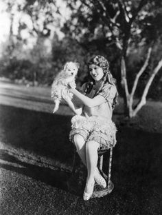 Mary Pickford holding a puppy.