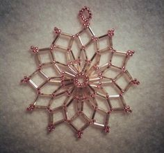 copper & champagne beaded web pendant    (champagne silver-lined bugle beads and copper silver-lined seed beads (size 11); netting stitch)