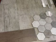 For inspiration only. These may be actual concrete tiles or stone, probably not porcelain, though not sure. Idea of a hexagon in a varying shade of colors yet natural material.