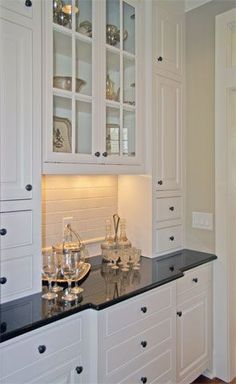 Fabulous u-shaped butlers pantry with ceiling height white cabinetry and granite countertops. Description from pinterest.com. I searched for this on bing.com/images