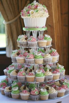 I love the giant cupcake on the top tier of this wedding cupcake stand! Also like the pink and green colors of the cupcake frosting - very springtime and summery feeling.