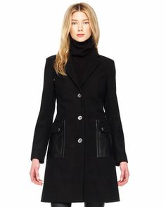 $425  Women's Leather-Trim Coat - MICHAEL Michael Kors Black felt with leather trim. Spread collar; button front. Long sleeves. Front leather pockets. A-line shape. Wool/polyester/nylon/other fibers; acetate lining. Imported.