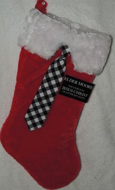 Missionary Christmas Stocking - Got the stocking at Target and a little kids tie as well. I cut the white part to look like a shirt and hot glued the tie in place. Then I made the tag and printed it on photo paper. I hot glued that as well {All I want for Christmas is you} http://aleighjoyful.blogspot.com/2012/12/all-i-want-for-christmas-is-you.html