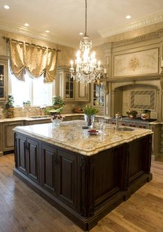 Beautiful kitchen with large island.  I would prefer one with a seating area but this is lovely.  And, of course, I do want crystal chandeliers in the kitchen (don't tell me about how difficult they would be to clean - I don't want to hear it).