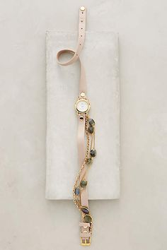 Awe Heawl. They went off and made it in Rosedust. Rosedust Wrap Watch - anthropologie.com