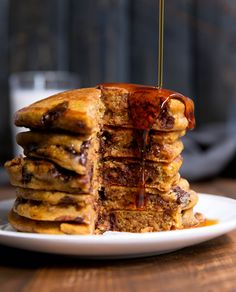 Ambitious Kitchen Fluffy whole wheat pumpkin chocolate chip pancakes. These healthy cakes are perfectly spiced and a wonderful breakfast treat. Tasty Pancakes, Pumpkin Pancakes, Pancakes And Waffles, Pumpkin Puree, Pumpkin Spice, Chocolate Chip Pancakes, Pumpkin Chocolate Chips, Healthy Cake, Healthy Pumpkin