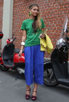 Milan Street Style - Spring Summer Fashion 2013 / More and more color  Green T block of Kenzo, capri pants cut wide klein blue and lemon yellow perfect. We love the original rectangular green slope fluorine.