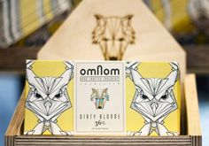 Omnom Handmade Chocolate The surface pattern of this design really caught my eye, the hand drawn geometric characters on the packaging are inspired from when the creators where living in Iceland. The idea of the shape of the packaging developed from a plain piece of folded A4 paper, now it's probably produced with a laser cutter, making it easier to mass produce..