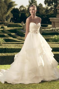 """Casablanca Bridal Ruffle A-Line Gown - Ruched, sweetheart bodice and the """"V"""" back neckline features matching crepe organza covered buttons along the zipper. The natural waist is accentuated with a detachable beaded belt adorned with Swarovski Crystals, an array of rhinestones, with 3-dimensional crepe organza flowers. The belt color matches the color of the satin lining of the gown."""