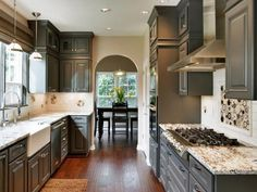 eclectic kitchen by Jason Ball Interiors, LLC. Behr Dark Granite on cabinets. Grey Kitchen Cabinets, Painting Kitchen Cabinets, Kitchen Paint, Dark Cabinets, Granite Kitchen, Upper Cabinets, Marble Countertops, Grey Cupboards, Colored Cabinets