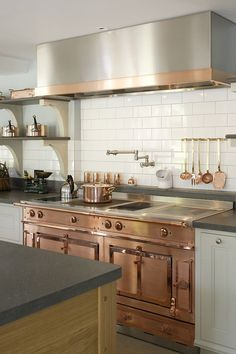 Custom copper and stainless steel La Cornue range in the bespoke kitchen
