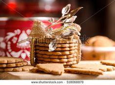 christmas homemade cookies and silver mistletoe over wood